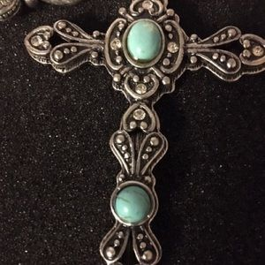 Jewelry - Intricately detailed silver tone cross necklace